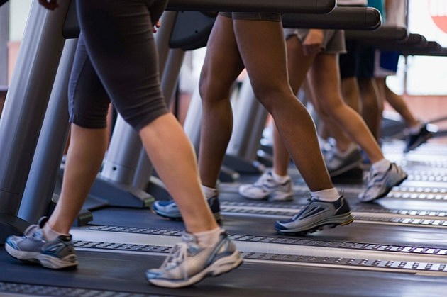 People on treadmills in gym